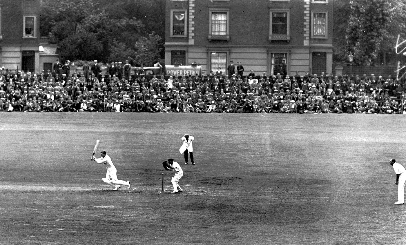 Wilfred Rhodes batting in front of a full-house