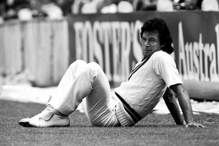 Imran Khan sitting in outfield